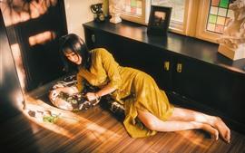 Preview wallpaper Asian girl, floor, interior, sunshine