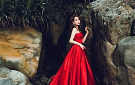 Preview wallpaper Asian girl, red skirt, rocks, art photography