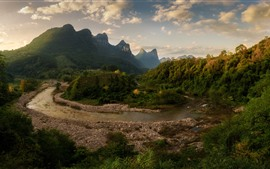 Beautiful countryside, river, trees, mountains, clouds