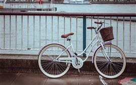 Preview wallpaper Bike, fence, river, city