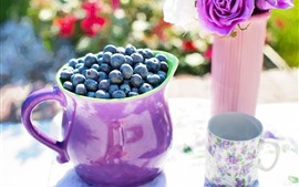 Blueberries, purple cup, flowers