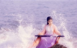 Preview wallpaper Chinese ancient costume girl, play guzheng at seaside, sea waves
