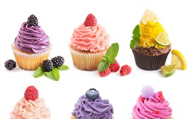 Colorful cupcakes, cream, berries, white background