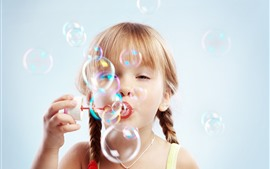 Cute child girl play bubbles