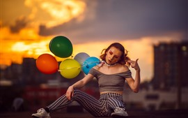 Preview wallpaper Girl sit on ground, colorful balloons, pose