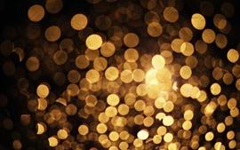 Círculos de luz dourados, brilham, abstraem