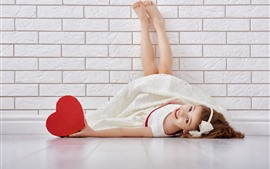 Preview wallpaper Happy Asian girl, lying on floor, red love heart, wall
