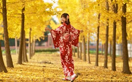 Preview wallpaper Japanese girl look back, smile, red kimono, trees, yellow leaves, autumn