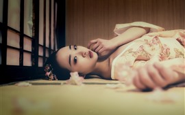Preview wallpaper Lovely Japanese girl lying on floor