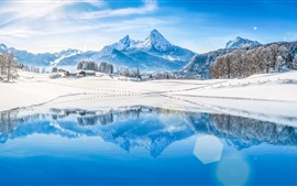 Preview wallpaper Mountains, trees, snow, lake, water reflection, winter