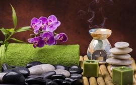 Phalaenopsis morada, piedras, vela, vapor