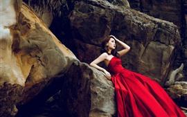 Preview wallpaper Red skirt Asian girl, rocks, pose