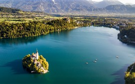 Preview wallpaper Slovenia, Lake Bled, island, city, trees, mountains, morning
