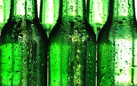 Three green bottles, water droplets