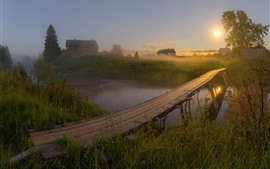 Preview wallpaper Village, river, wood bridge, grass, house, fog, sun, morning