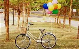 Preview wallpaper White bike, colorful balloons, trees