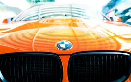 Preview wallpaper BMW logo, orange car