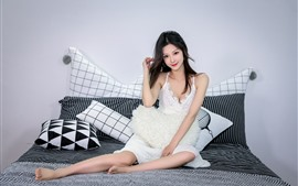 Preview wallpaper Beautiful Asian girl, smile, bed, pillow