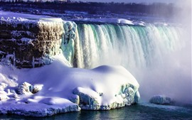 Beautiful Niagara Falls, thick snow, water stream, fog, Canada