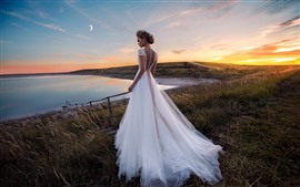 Preview wallpaper Beautiful bride, white skirt, grass, lake, moon, dusk