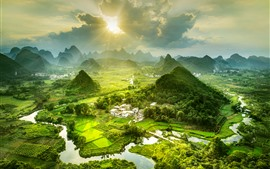Beautiful countryside landscape, mountains, village, river, fog, sunshine, China