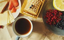 Pão, biscoitos, café, laranjas, café da manhã