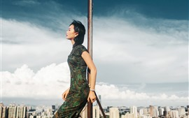 Preview wallpaper Cheongsam woman, roof, sky, clouds