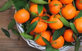 Fresh fruit, tangerines, oranges, leaves