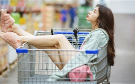 Preview wallpaper Girl sit on shopping cart