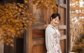 Preview wallpaper Happy Asian girl, gate, leaves, autumn