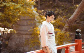 Preview wallpaper Japanese girl, thinking, fence, park