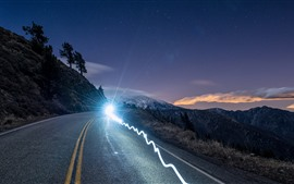 Preview wallpaper Mountains, road, glare headlight, dusk