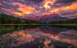 Mountains, trees, clouds, sunset, lake, water reflection