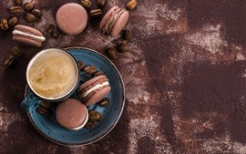 Una taza de café, macaron, comida