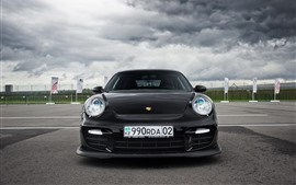Preview wallpaper Porsche 911 black car front view, thick clouds