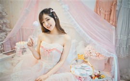 Preview wallpaper Smile Asian girl, lovely, bed, skirt