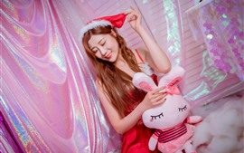 Preview wallpaper Smile Christmas girl, rabbit toy