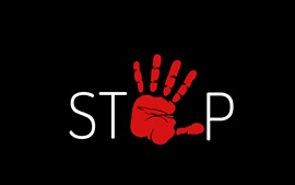 Stop, red hand, black background