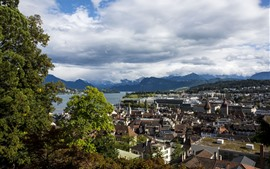 Preview wallpaper Switzerland, Lucerne, city, houses, river, mountains, clouds, trees