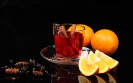 Tea, cinnamon, oranges, black background