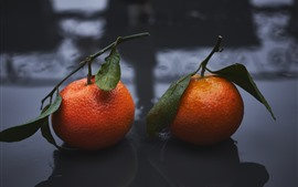 Two tangerines, water droplets
