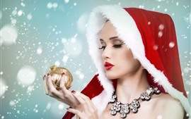 Preview wallpaper Beautiful Christmas girl, look at Christmas ball, snow