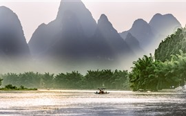 Beautiful Lijiang, mountains, river, sun rays, boat, China