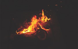 Preview wallpaper Fire, flame, firewood, sparks, darkness
