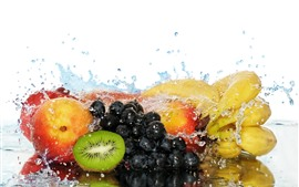 Fruit, grapes, kiwi, peach, banana, water droplets, white background