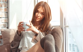 Preview wallpaper Girl sit on chair, cup, window, sunshine