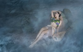 Girl sleep in the water, swimsuit, pipa