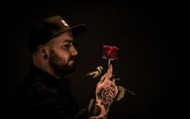 Preview wallpaper Man, tattoo, cap, red rose, darkness