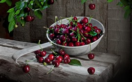 Many fresh cherries, water droplets, delicious fruit