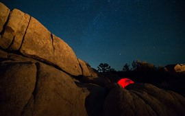 Preview wallpaper Mountains, rock, tent, starry, night